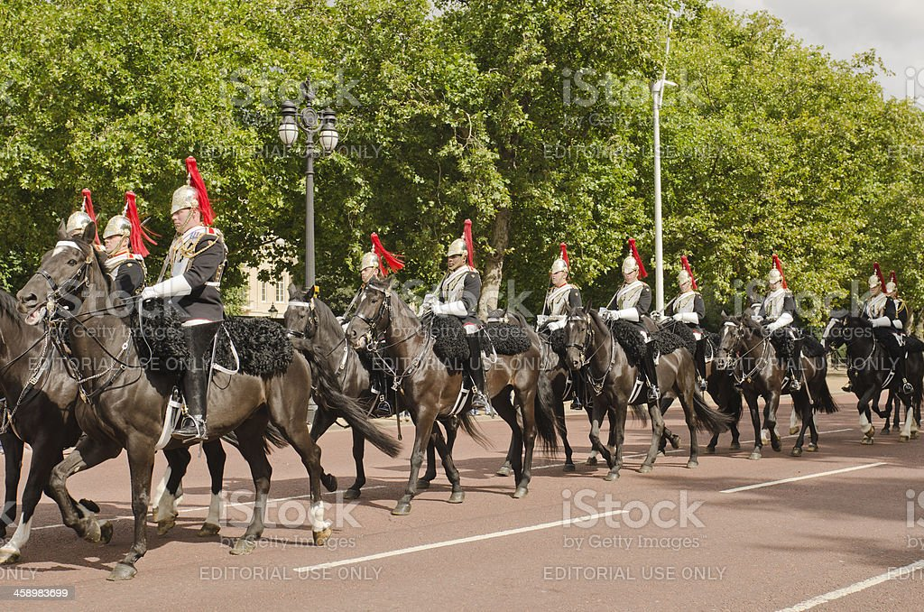 Royal Guard on horses are riding in front Buckingam Palace stock photo