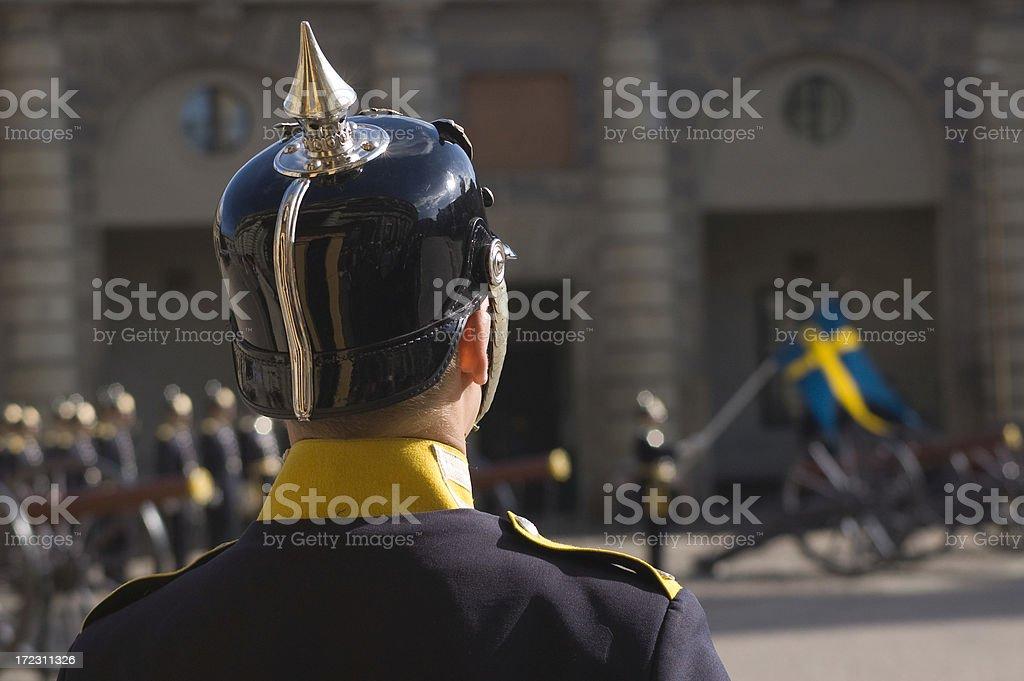 Royal guard watching the flag royalty-free stock photo