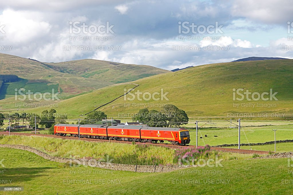 Royal Mail train passing through scenic Scottish countryside stock photo