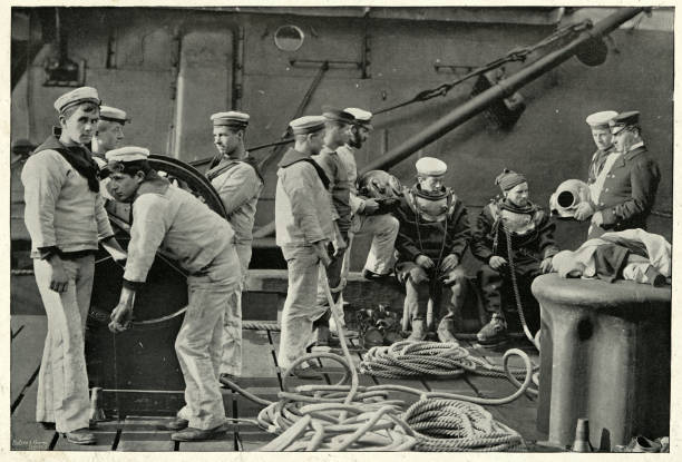 Royal Navy divers putting on diving suit, 19th Century Vintage photograph of Royal Navy divers putting on diving suit, 19th Century sailor suit stock pictures, royalty-free photos & images