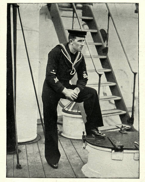 Royal Navy sailor, Coxswain of HMS Theseus, 1890s, 19th Century Vintage photograph of a Royal Navy sailor, Coxswain of HMS Theseus, 1890s, 19th Century sailor suit stock pictures, royalty-free photos & images