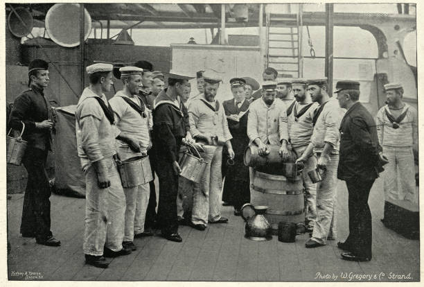Royal navy sailors receving a ration of Grog (Rum), 1895 Vintage photograph of Royal navy sailors receving a ration of Grog on board HMS Royal Sovereign, 19th Century sailor suit stock pictures, royalty-free photos & images
