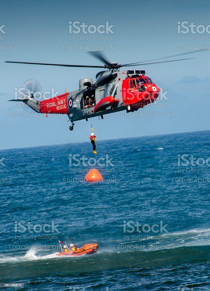 Royal Navy Sea King Helicopter and Lifeboat During Rescue stock photo