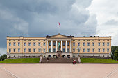 Oslo, Norway - June 26 2019: The Royal Palace (Norwegian: Slottet or formally Det kongelige slott) was built in the first half of the 19th century as the Norwegian residence of the French-born King Charles III of Norway, who reigned as king of Norway and Sweden.