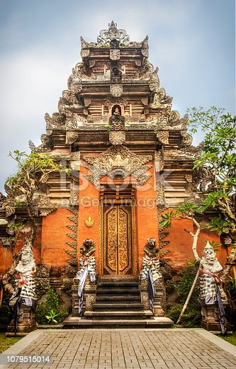 The Ubud Royal Palace is one of the most prominent places in Ubud, as it is smack-dab  on the main Jalan Raya Ubud road and intersection. The palace can also be regarded  as the focal landmark of Ubud. The Ubud palace was built during the lordship of the  late Ida Tjokorda Putu Kandel (1800-1823), and is well-kept by his successive heirs.  A visit to the Puri Saren is on many of the itineraries to the Ubud area.  It has well-preserved Balinese architecture and charming garden settings,  and is best known among lovers of Balinese arts