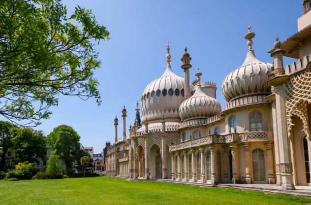 Royal Pavilion Brighton East Sussex Southern England UK BRIGHTON, UK - JUN 5, 2013: Extravagant facade of the Royal Pavilion or Brighton Pavilion, former royal residence built in the Indo-Saracenic style pavilion stock pictures, royalty-free photos & images