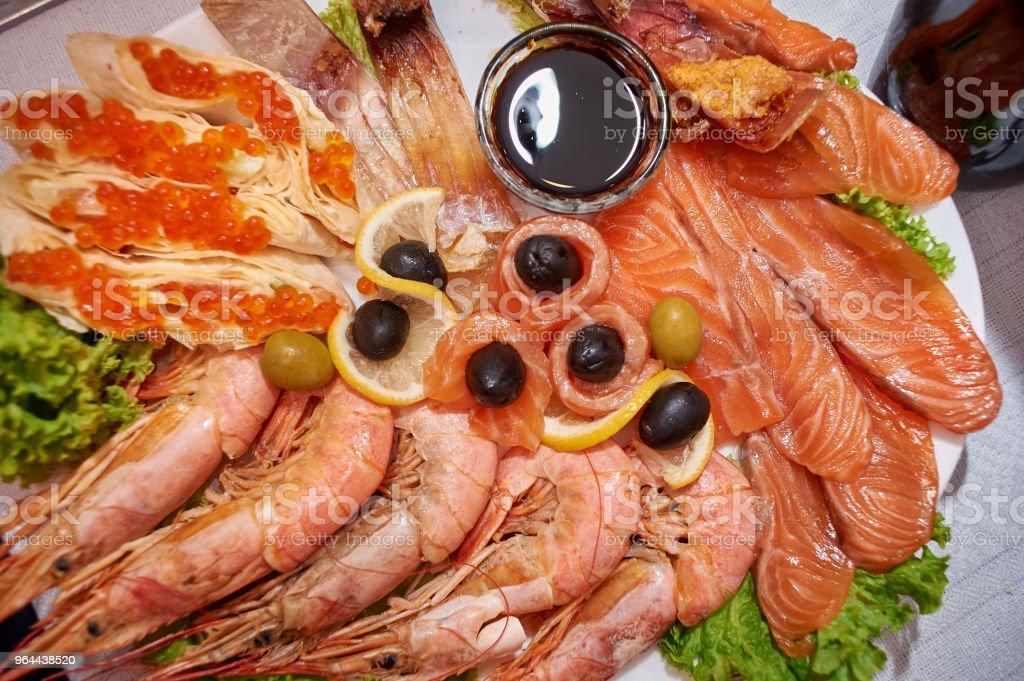 Royal prawns, pancakes with caviar, salmon, river smoked fish - Royalty-free Cooked Stock Photo