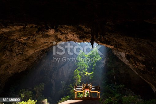The famous Royal Sala in Phra Nakorn Cave in Khao Sam Roi Yot, Prachuab Khiri Khan Province, Thailand, which was built under the reign of King Rama 5th, over a century ago. The cave located high up in one of the peaks of Sam Roi Yot National Park has an opening at the top in which sunlight streams down on to the elegant Sala.