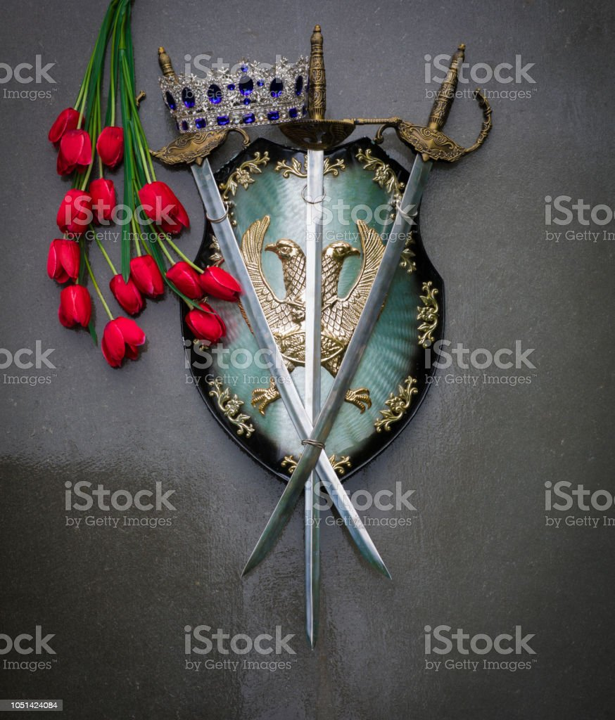 royal shield and crown on a gray background stock photo