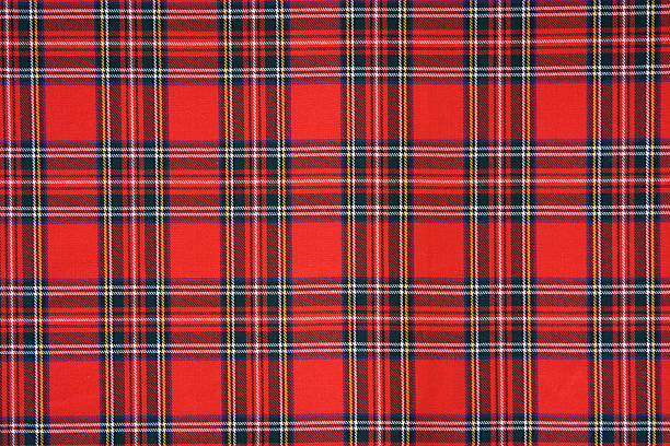 Royal Stewart tartan design cloth The Royal Stewart Tartan is the tartan of the royal House of Stewart, and is also the personal tartan of Queen Elizabeth II plaid stock pictures, royalty-free photos & images