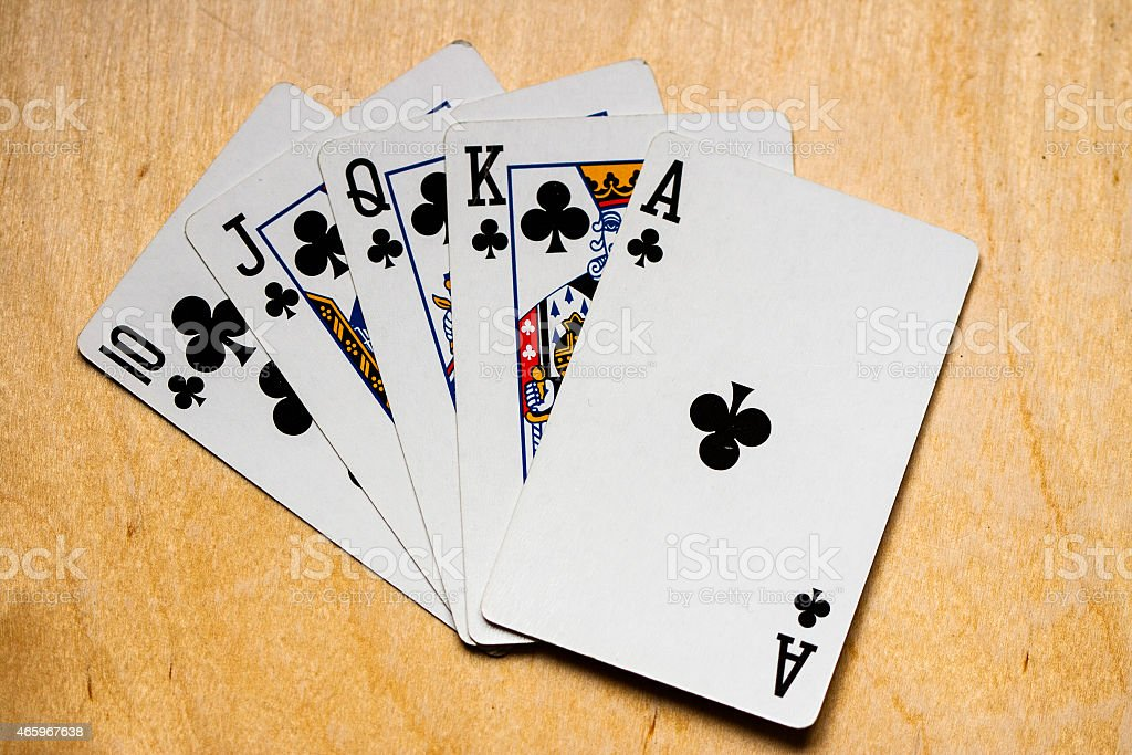 Royal straight flush with clubs stock photo