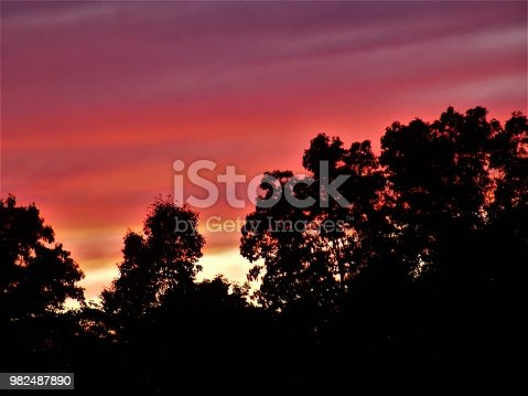 Rich and Vibrant Shades of Red and Orange Paint this Evening's Sky as the Day winds Down - Evening Sky - Clouds are Beautiful at Sunset