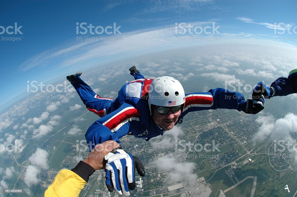 Royalty Free Stock Photo:  Freefall Red White  Blue Skydiver stock photo