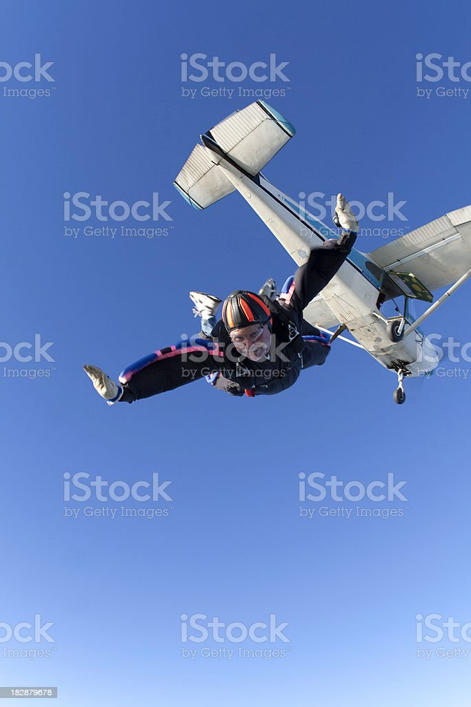 Royalty Free Stock Photo: Skydiver And a Cessna 182 Airplane royalty-free stock photo