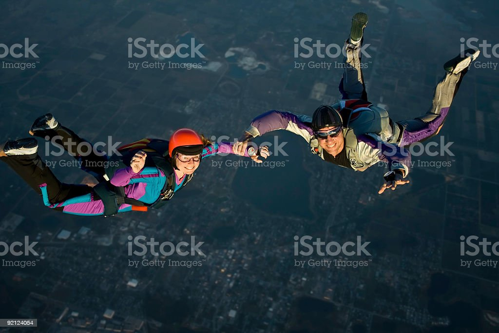 Royalty Free Stock Photo: Skydiving Couple - Come Join Us royalty-free stock photo