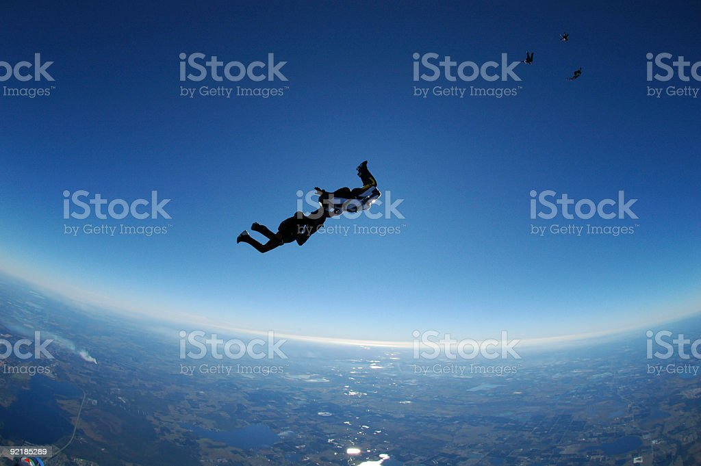 Royalty Free Stock Photo: Teamwork - Backlit Skydivers stock photo