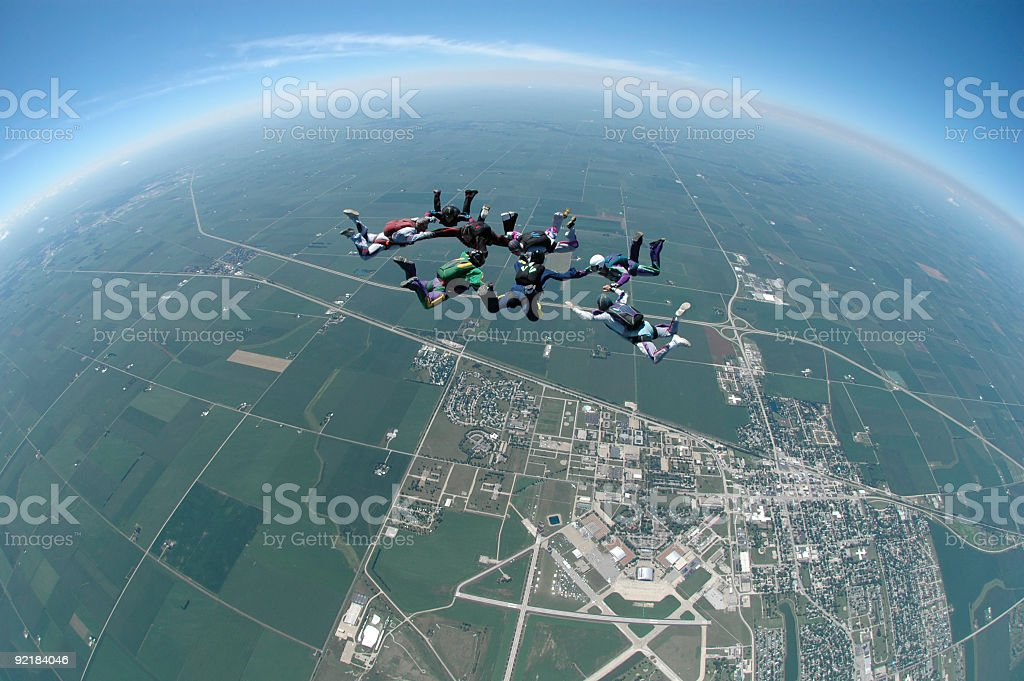 Royalty Free Stock Photo: Teamwork - Eight Skydivers Over Rantoul royalty-free stock photo