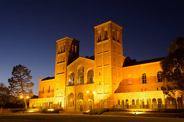 UCLA Royce Hall after Sunset Los Angeles, California, USA - August 28, 2011: Royce Hall on University of California, Los Angeles campus after sunset. Modeled after Milan's Basilica of Sant'Ambrogio, Royce Hall is one of the four UCLA original buildings. ucla medical center stock pictures, royalty-free photos & images