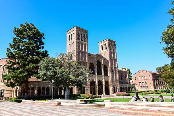 Royce Hall at the University of California, Los Angeles (UCLA) Los Angeles, California, USA - July 9. 2015: A group of studens walk past Royce Hall at the Univrsity of California, Los Angeles (UCLA) campus. westwood neighborhood los angeles stock pictures, royalty-free photos & images