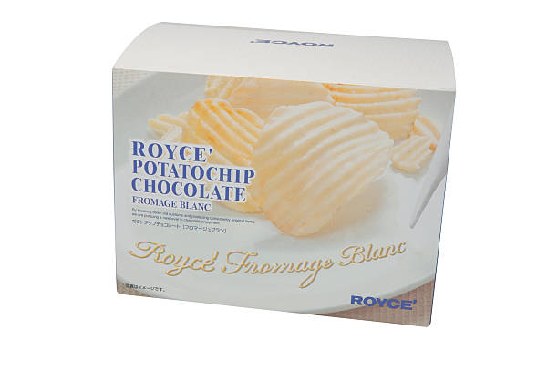 Royce' White Chocolate Potato Chips Adelaide, Australia - May 25, 2014: A Studio shot of a box of Royce Chocolate Potato Chips. Popular Japanese Chocolate maker which sells its products internationally. royce lake stock pictures, royalty-free photos & images