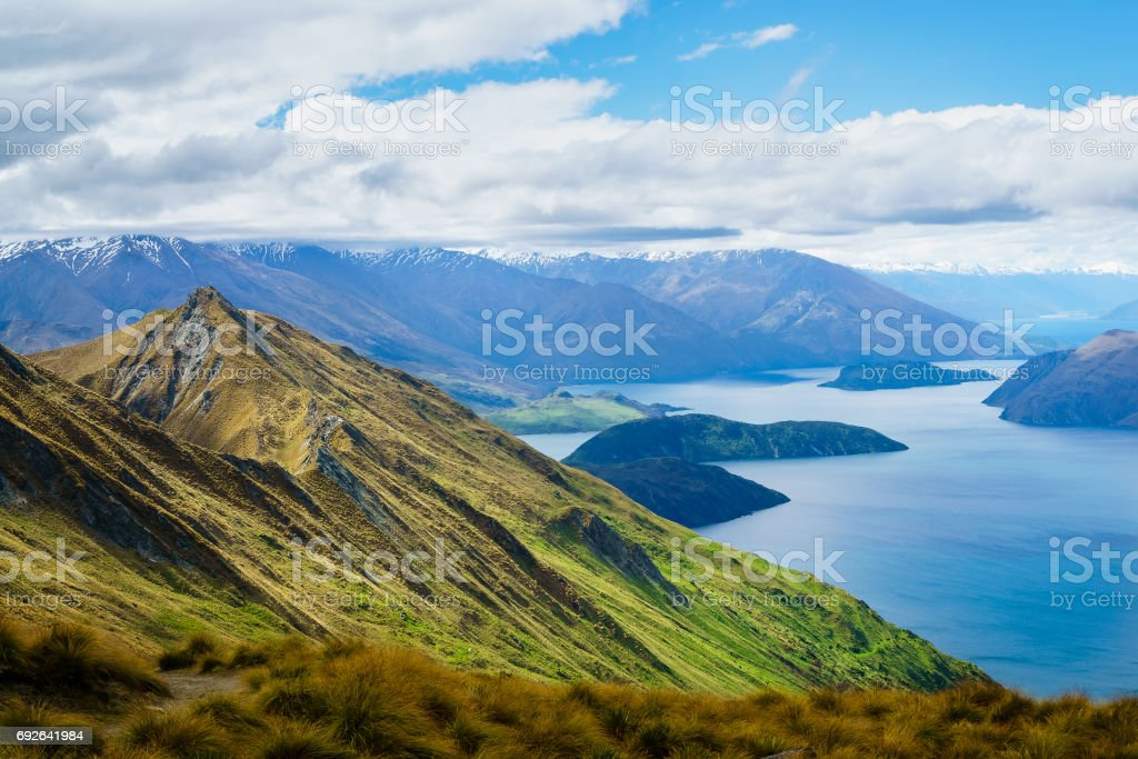 Roy's Peak in Wanaka with Wanaka Lake and Mountains in the Distance stock photo