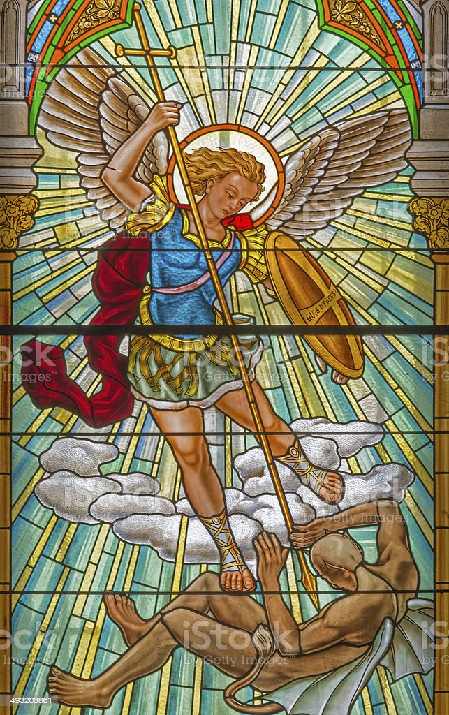 Roznava -  Archangel Michael in windowpane of the cathedral stock photo