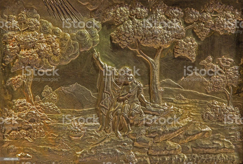 Roznava - Metal relief of Abraham and Isaac in cathedral stock photo