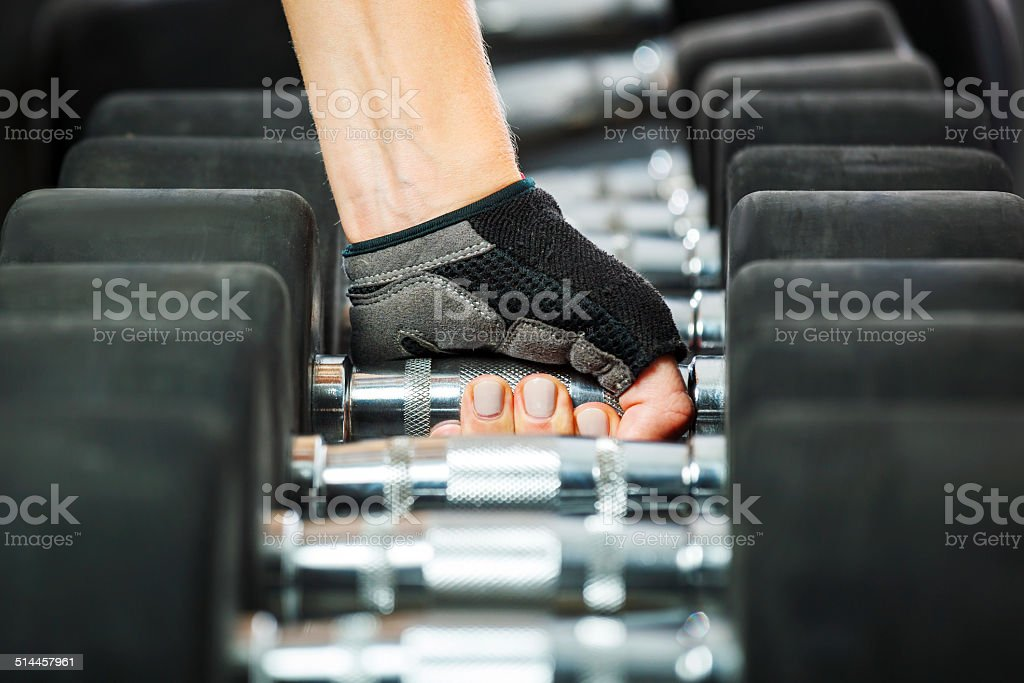Rrack with metal dumbbells in gym. stock photo