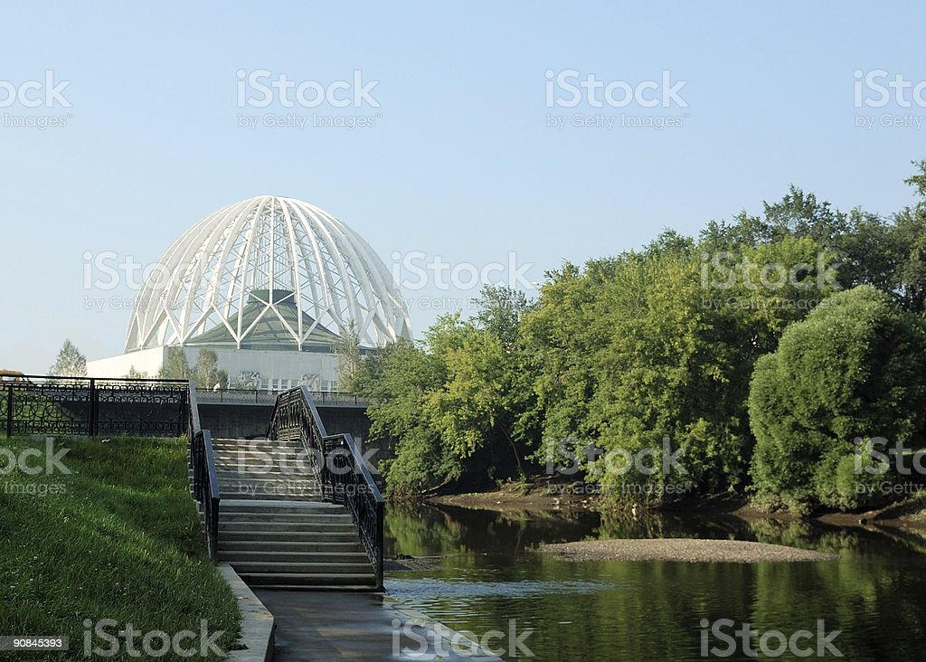 Rriverbank landscape with delicate building and staircase royalty-free stock photo
