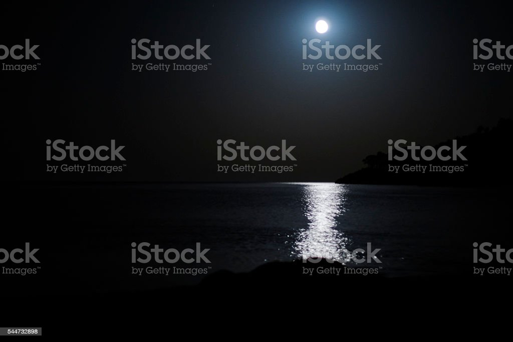 Rİsing Moon Over Sea stock photo