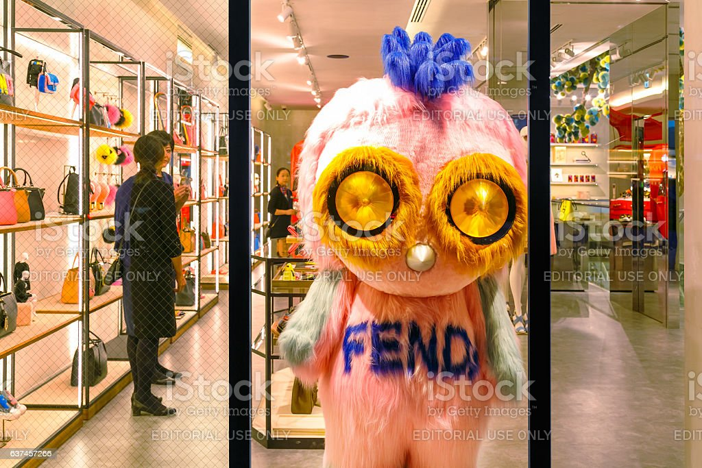 rtoon mascot in front of Fendi boutique at Ginza district stock photo