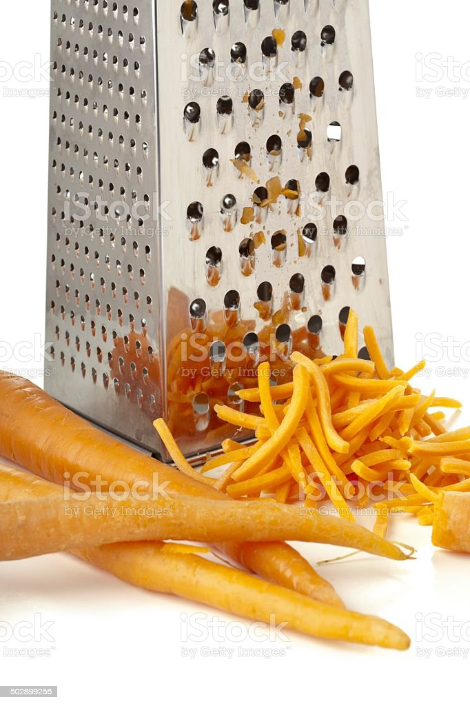 rub carrots and grater stock photo