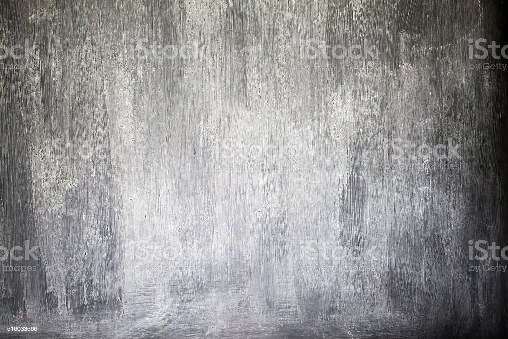 Rubbed out chalk on blackboard, close up stock photo