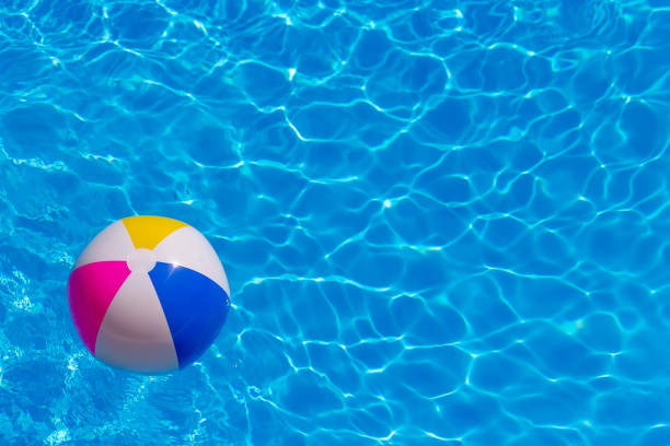 Rubber ball in the pool stock photo