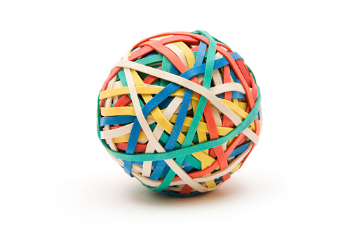 Ball made of multi colored rubber bands. Isolated on a white background.