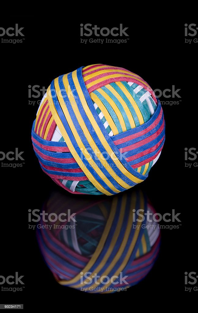 Rubber band ball on black surface stock photo