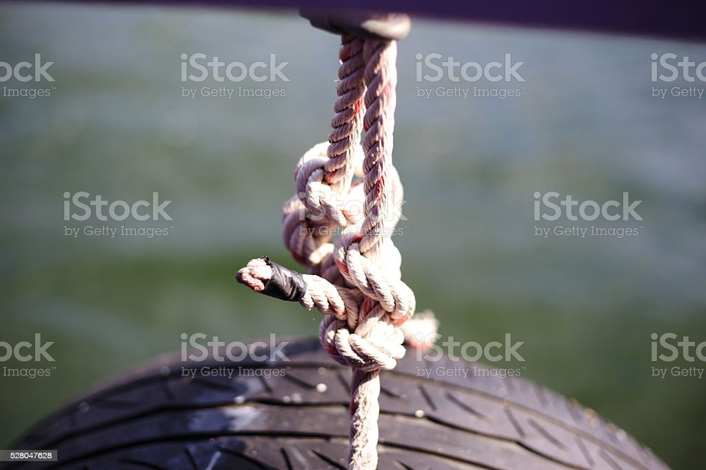 rubber beside boats intended for cushioning the port stock photo