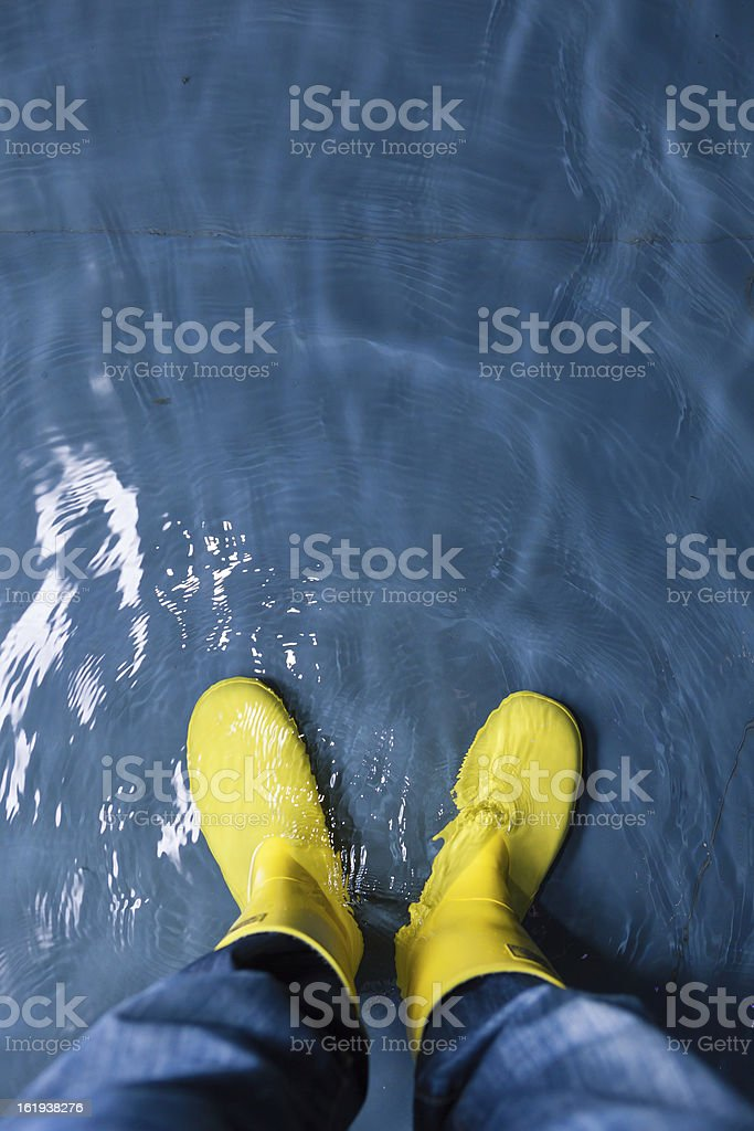 rubber boots in the water stock photo