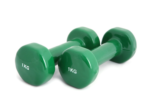 Two rubber coated dumbbell on white background