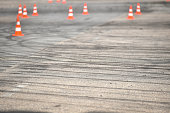 Rubber drift traces and traffic cones inside a driving school polygon