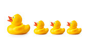 Rubber duck and ducklings on white background.