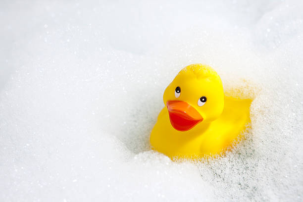 Rubber duck bubble bath A cheerful yellow rubber duck in a bathtub full of soapy bubbles.See similar: bubble bath stock pictures, royalty-free photos & images