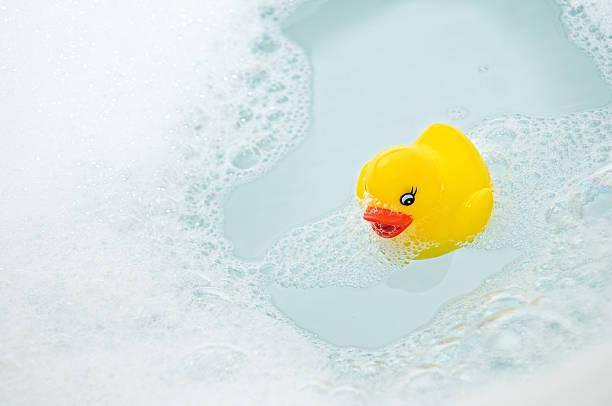 Rubber Duck in the Bath Tub stock photo
