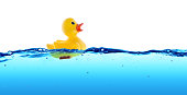 Rubber duck swimming in blue water - positive concept