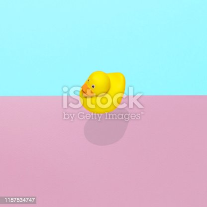 istock Rubber duck toy flies in the air 1157534747