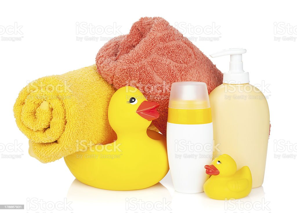 Rubber duck with bath towel and bottles royalty-free stock photo