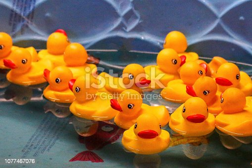 a carival  game , a pool of rubber duckies