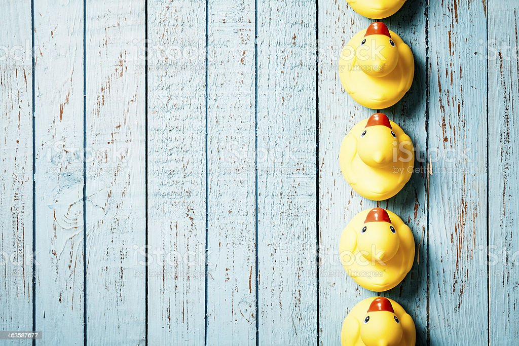 Rubber Ducks on Blue Vintage Wood Background - Grunge Old stock photo