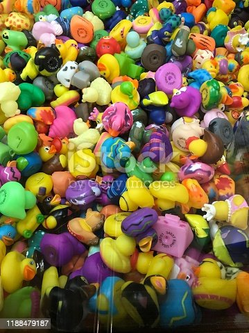 Different bright color rubber ducks in a toy machine. Full screen close up shot.