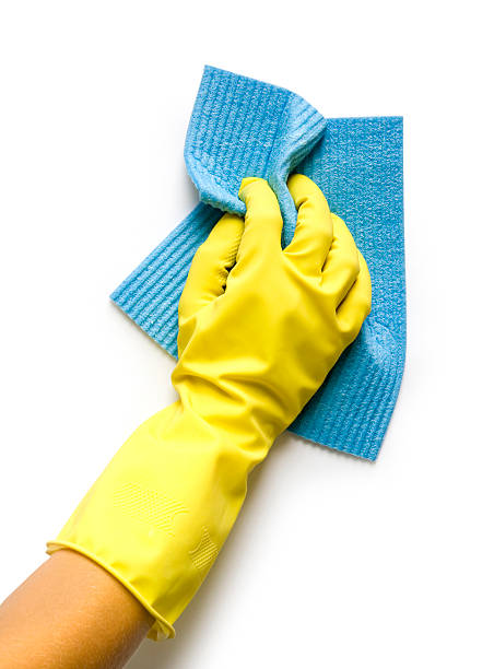 Rubber gloved hand cleaning with a blue cloth stock photo